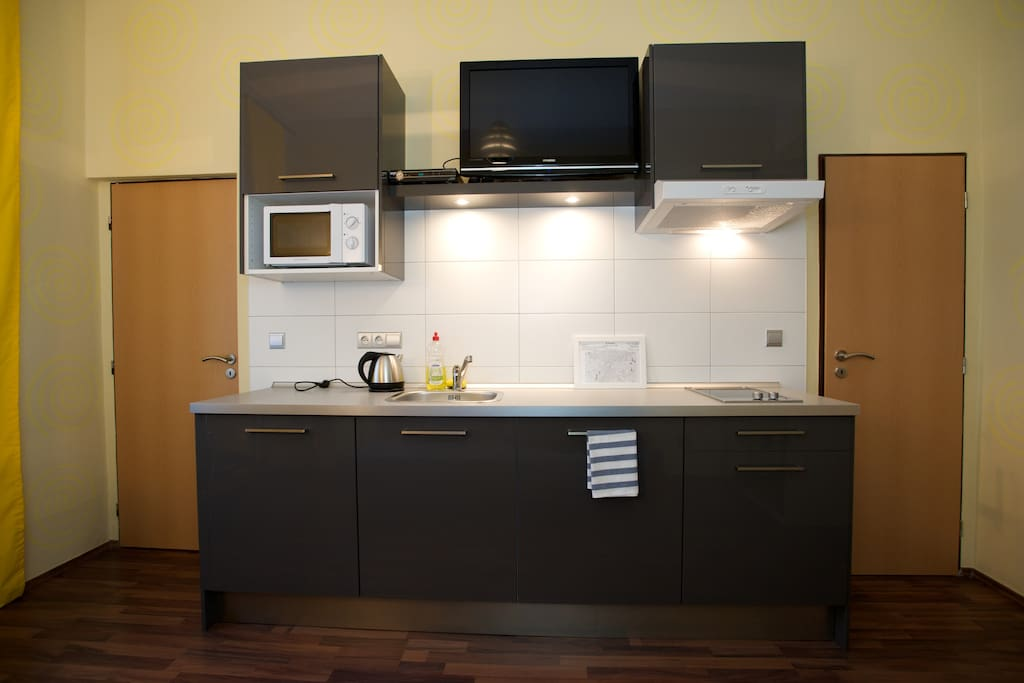 fully equipaed kitchen  with kettle, microvawe oven,  toaster and koffee maker