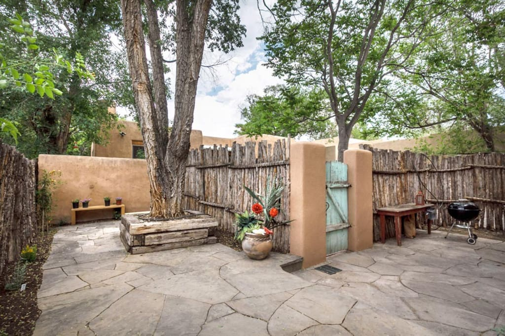 Great outdoor patio with a hot tub, BBQ grill, and outdoor seating.