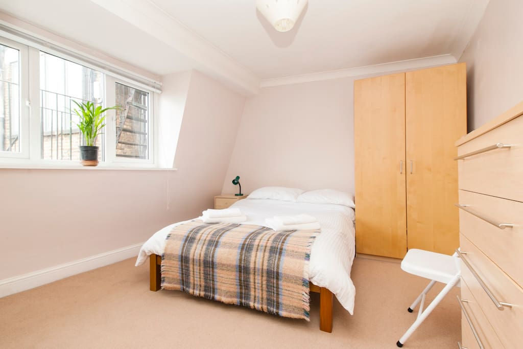 light and sunny double room with a comfortable double bed