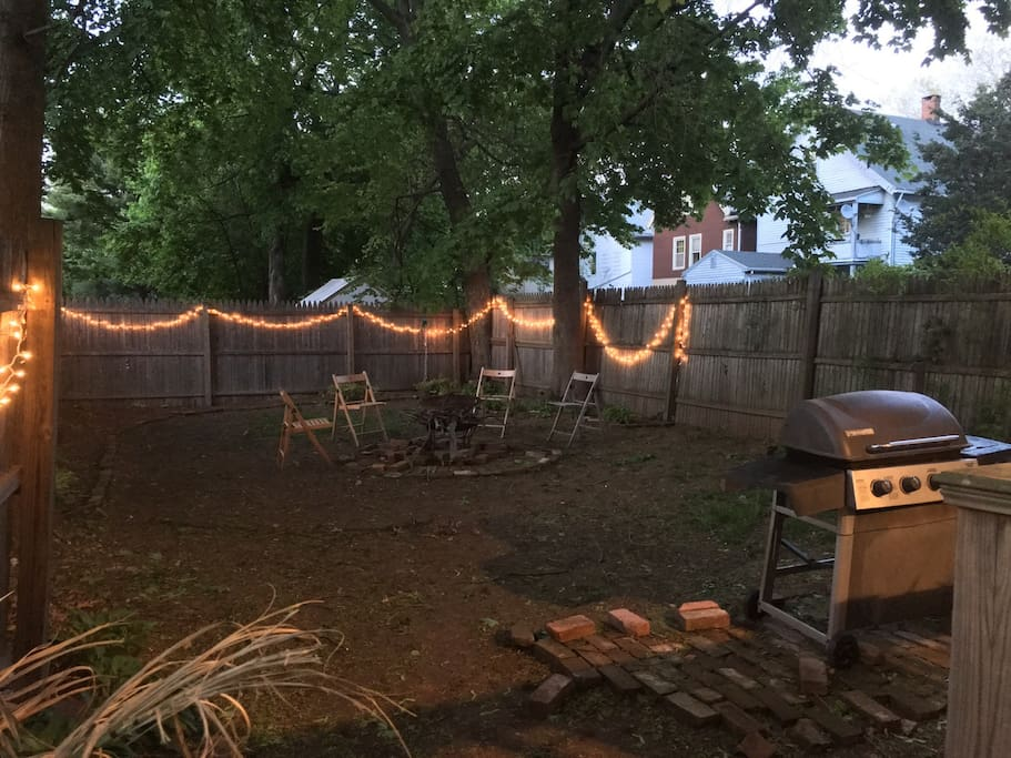 Fenced in back yard with fire pit