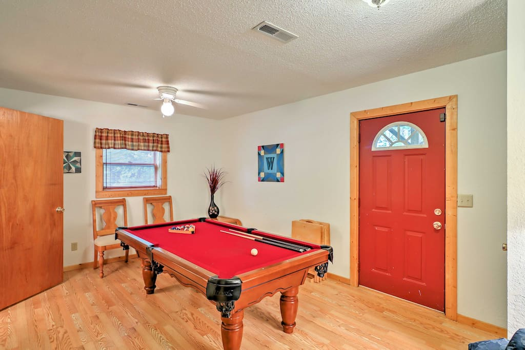Enjoy family game nights at home in the rec room.