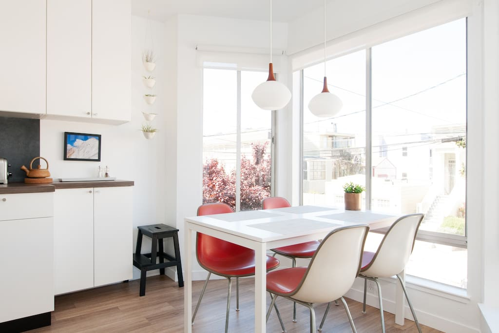 Enjoy your meals on Herman Miller Eames chairs, surrounded by local art, views, and bright northern light, all day long through the giant windows.