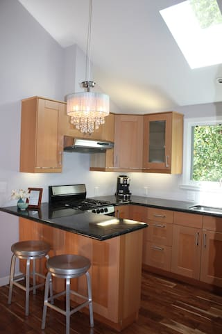 Very large kitchen that is fully stocked