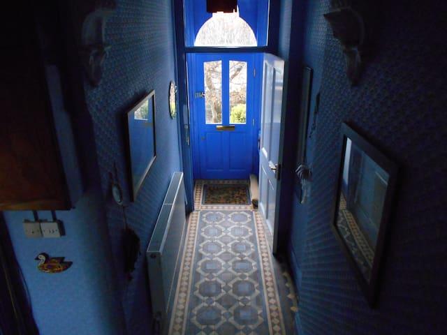 The front door and Victorian tiles