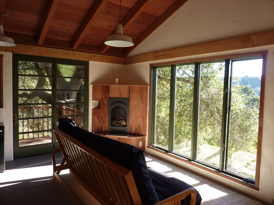 Living area overlooking farm below and Pacific Ocean out the picture windows