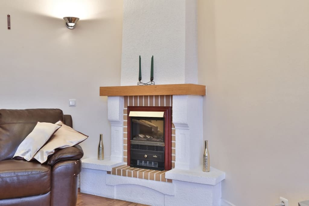 Large LCD Tv and cozy fireplace