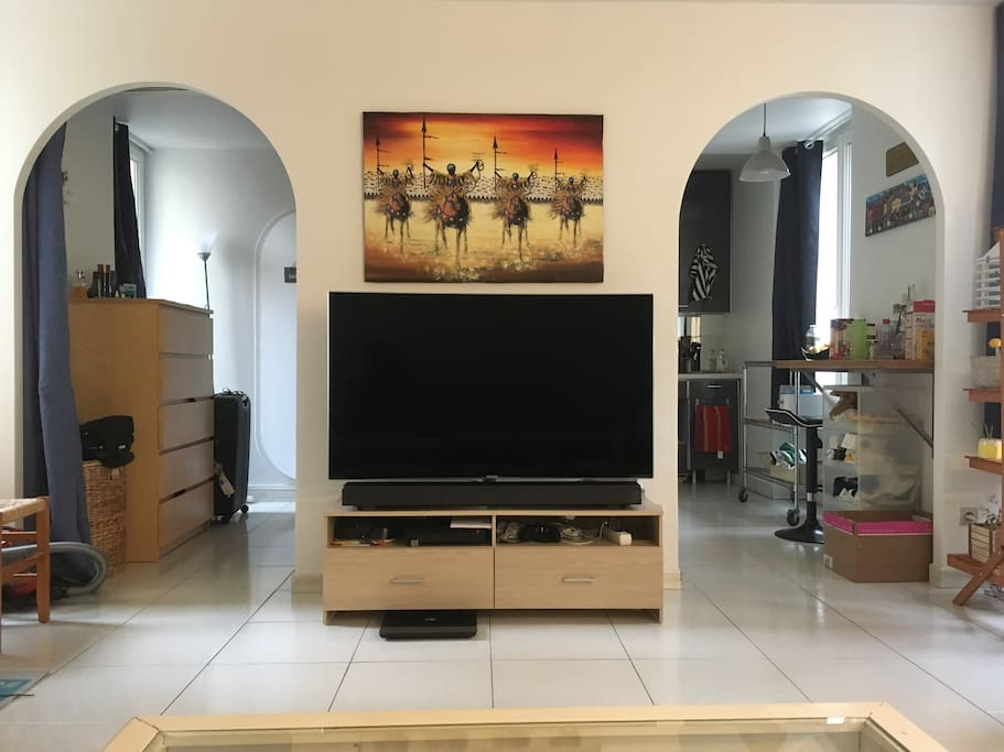 Bright living room with new TV