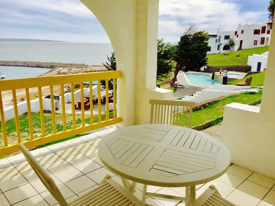 Private balcony with beautiful view over the ocean enjoying your sundowners and watching the kids swim