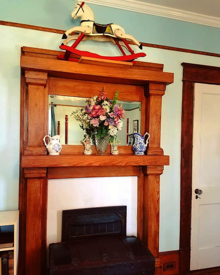 The guest room's vintage mantel decorated with family heirlooms