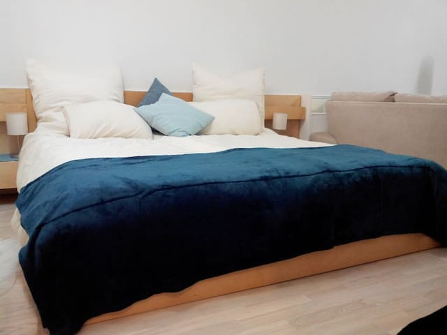 King Sized Bed with  4 Pillows and choice of 2 Single or 1 King Sized Duvet