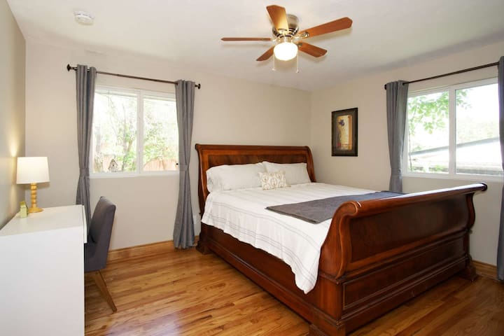 Master bedroom on the main floor complete with en suite bathroom, beautiful king sleigh bed, tons of closet space, desk in case you are on a working v