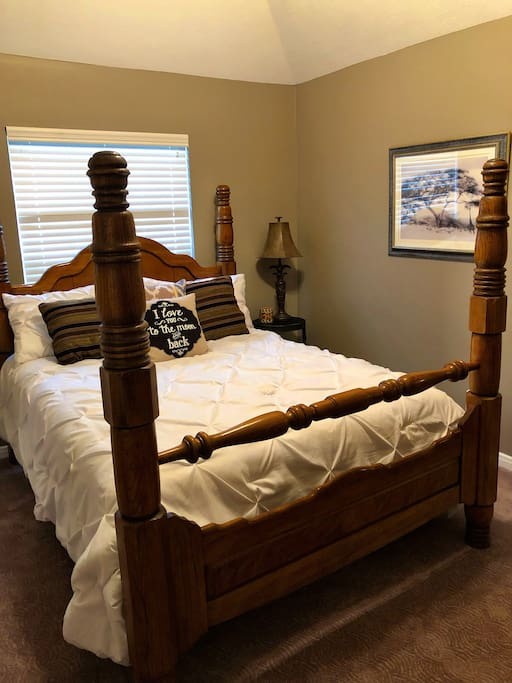 Guest bedroom with queen bed and double closets