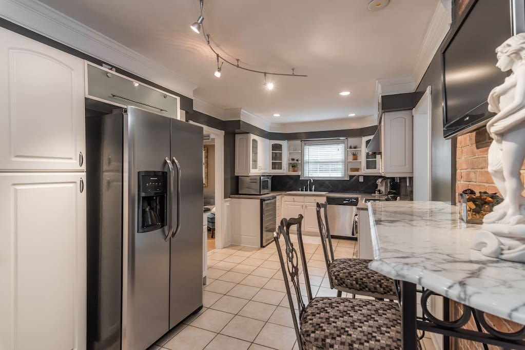 Yes, the kitchen is huge, spacious, has no shortage of seating, and has a TV :)