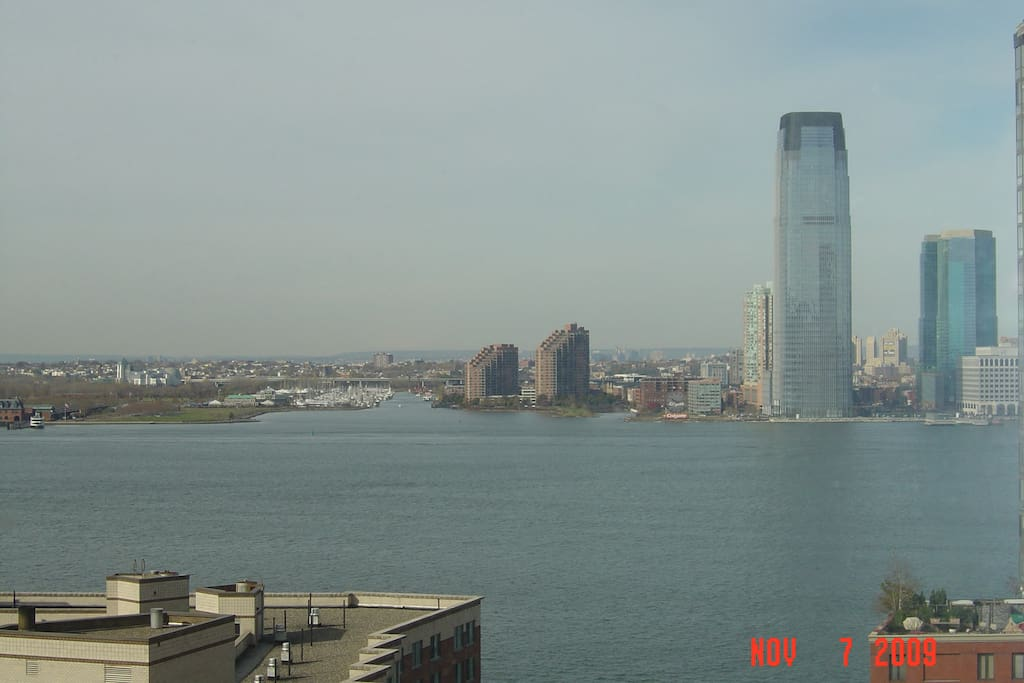 Hudson River view from terrace during the day - New Jersey in background