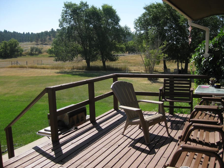Relax on the front porch and enjoy watching the horses!