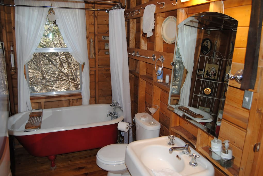 clawfoot tub and hand-held shower only - outdoor shower under cabin for nudists only