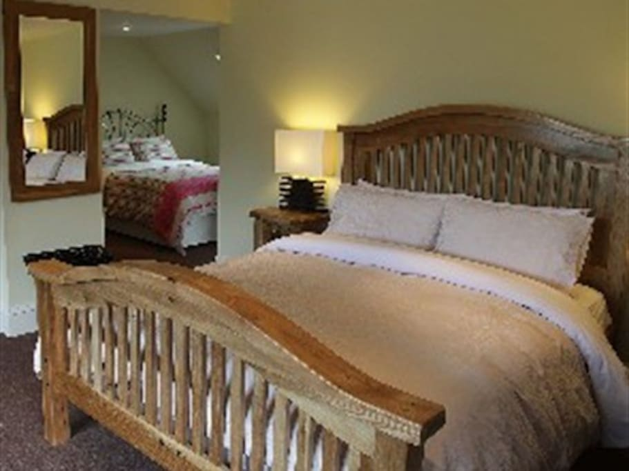King bed overlooking secondary bed area