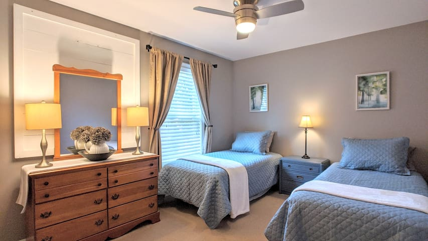 Two more twin sleeping spaces in this inviting bedroom.