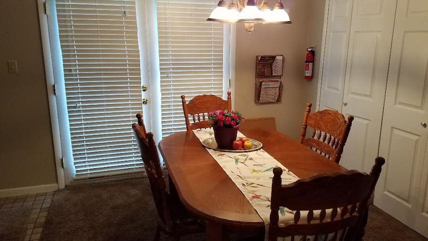 Four chairs are included at the table, however two additional chairs can be brought in from the bedrooms to seat a total of 6.