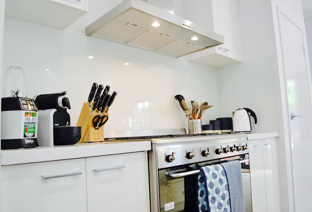 Modern kitchen with new appliances, stainless steel oven, dishwasher, microwave and fridge. Also included are the Ninja and Nespresso coffee machine ☕️