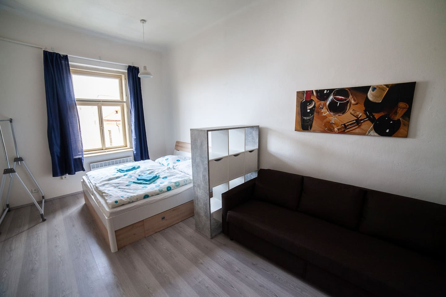Bright room with brand new furniture, king size double bed, opening sofa bed, own kitchen and shower corner, with shared toilet with another guests