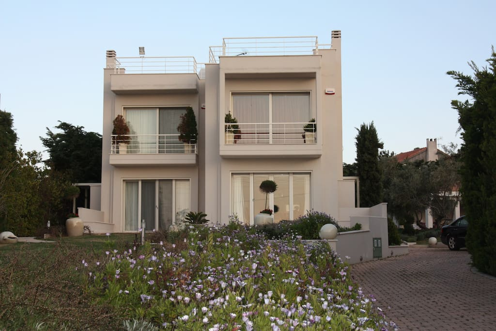 Coral Villa (right) and Acanthus Villa (left) of 'The Marble Resort' (front view)