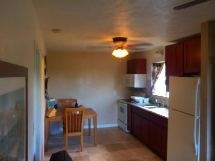 Granite counters, tile floors, full size appliances