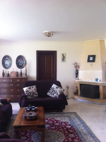 Comfortable and homely environment, traditional  fire place in living-room