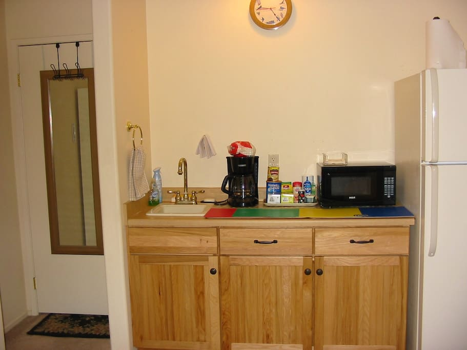 Bedroom #1 - Kitchenette has microwave, coffee maker and refrigerator. Tea also offered.