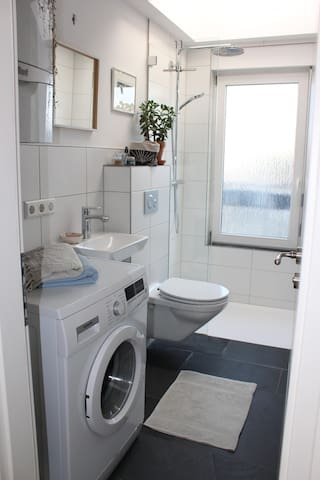 Second bathroom with rainshower and washing machine
