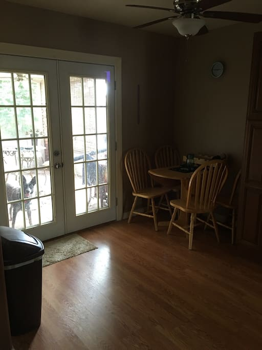 Eat in kitchen outside patio for smoking and dining access to a large yard outside grill and table available also