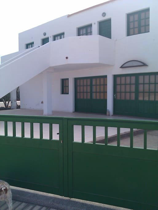 Wide terrace  at two steps of the sand.