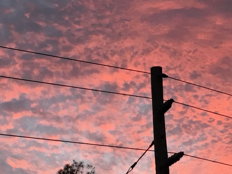 Sunset taken from the front porch  One week ago  (unaltered)