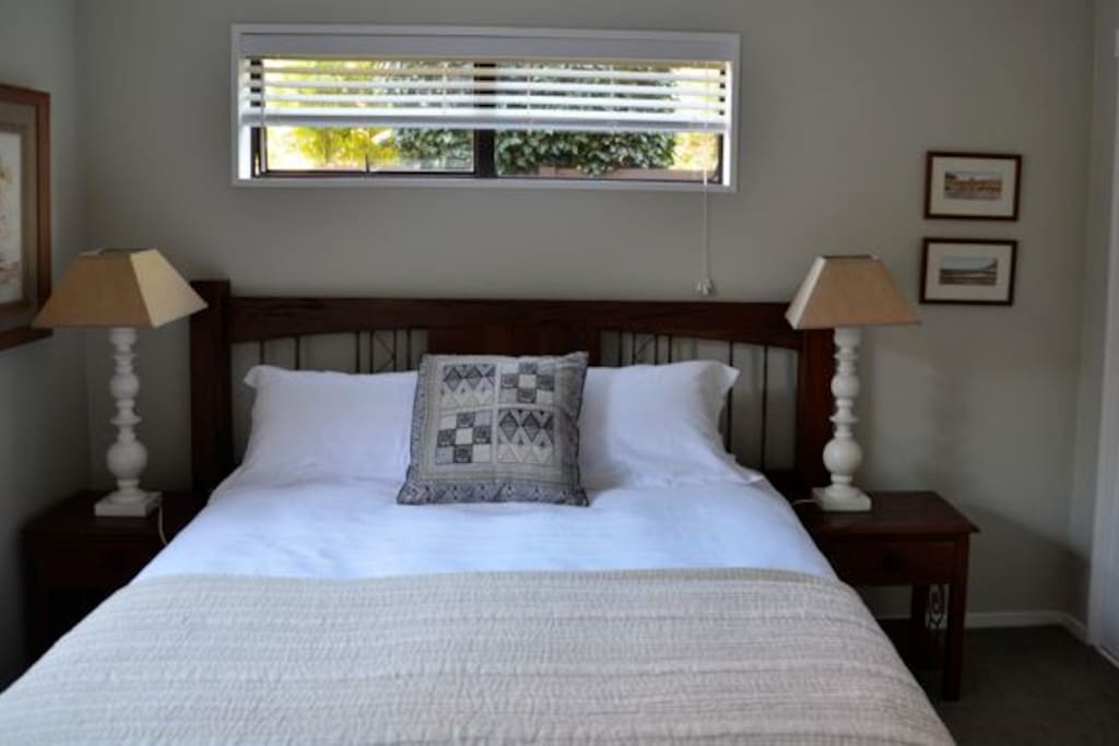 Ground floor bedroom with Queen sized luxurious bed and top quality linen