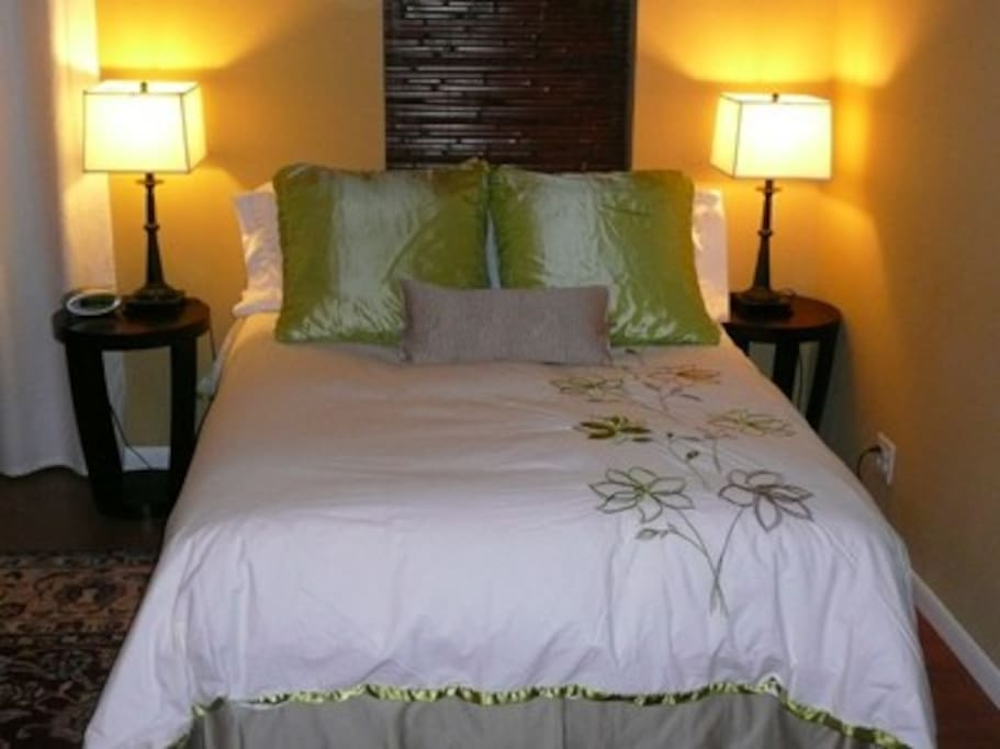 A comfy bed with very nice sheets await you.