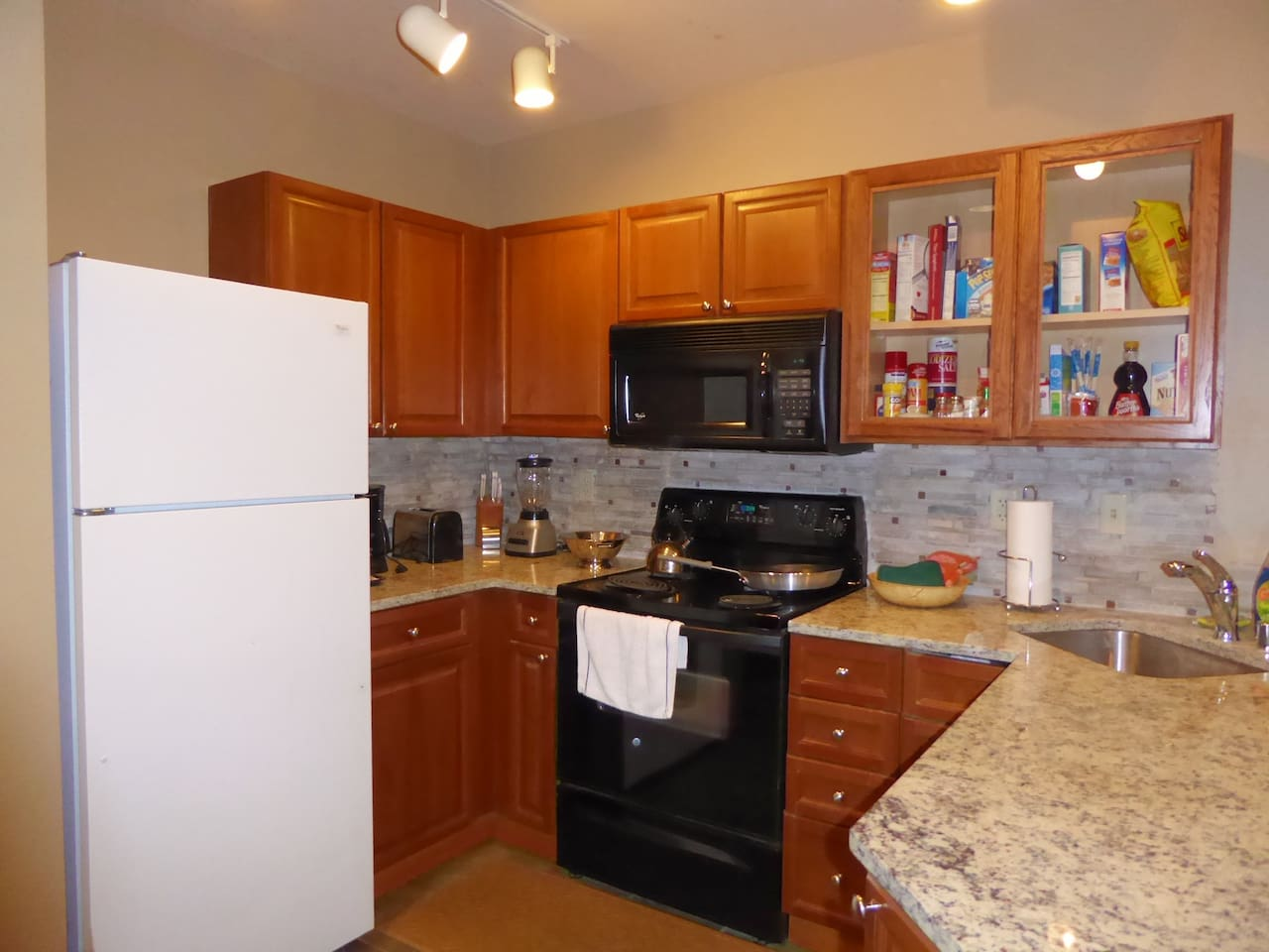 Kitchen with new granite and corner sink/faucet