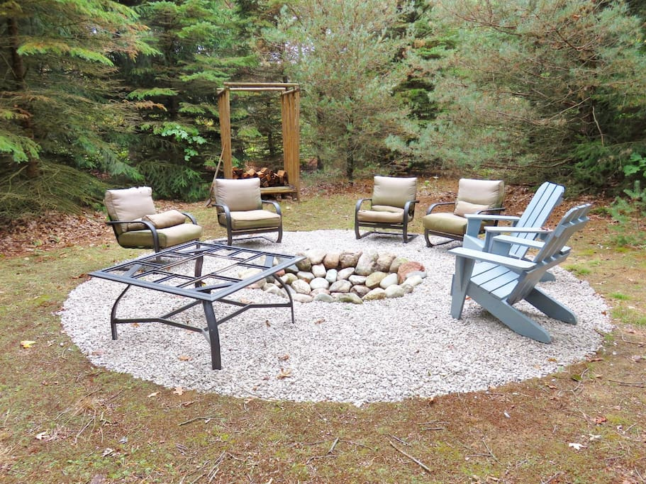 Amazing fire pit in the woods perfect for s`mores and stories