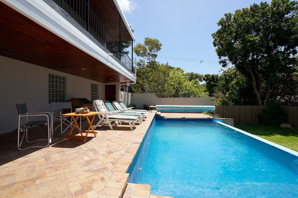 Relax next to warm, solar heated pool