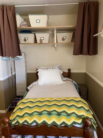 Twin bed, portable hanger, storage