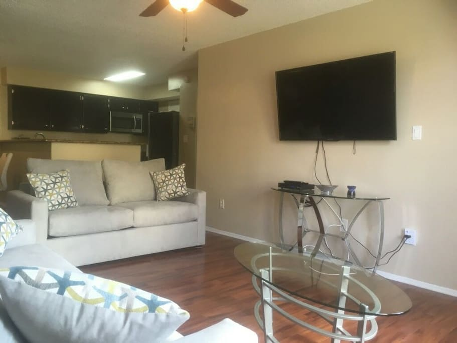 Smart TV with cable, ceiling fan.