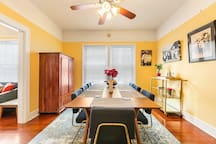 Large dining room table has seating and dinnerware for 8 people