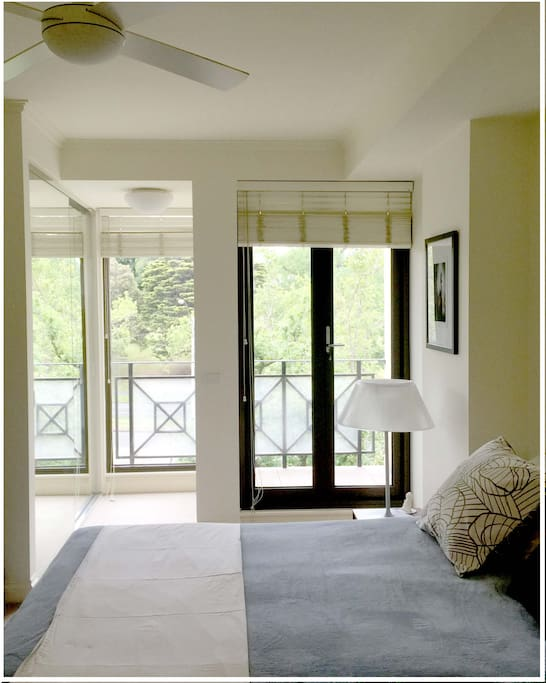 Master bedroom with queen size bed, ensuite, fan and aircondlting and private balcony in the room.