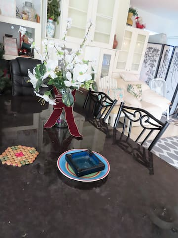 Smoking is allowed in patio area 1 Leather Luxury Chair for you to feel like a King/queen. Enjoy the ocean cool wind we are only1 mile from the beach. A romantic way to have each other feel loved: enjoy breakfast, Coffee, talk with one another LOVE