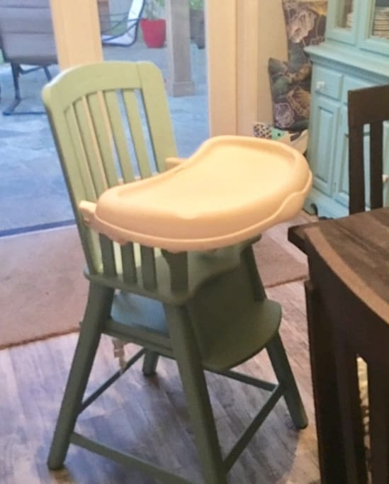 highchair and portable crib offered for young children