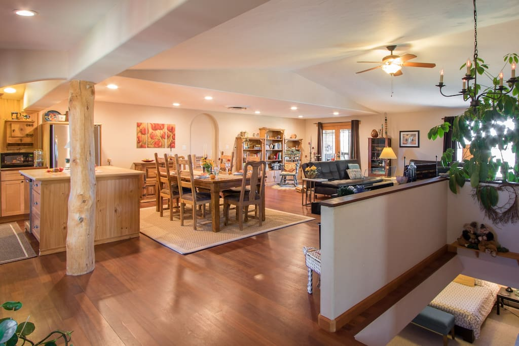 Spacious Southwestern family style kitchen with view of lower level bedroom.