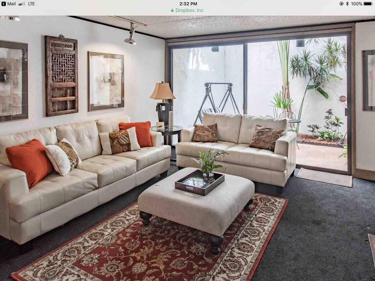 Living room showing adjacent back courtyard