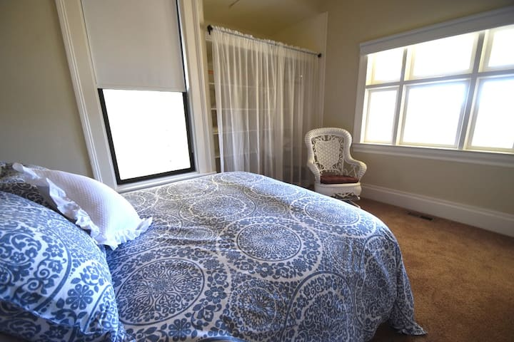 bedroom with a fold-out floor mattress for a child.