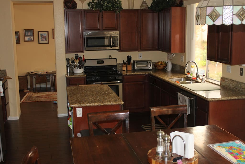 Open kitchen area with dining room table