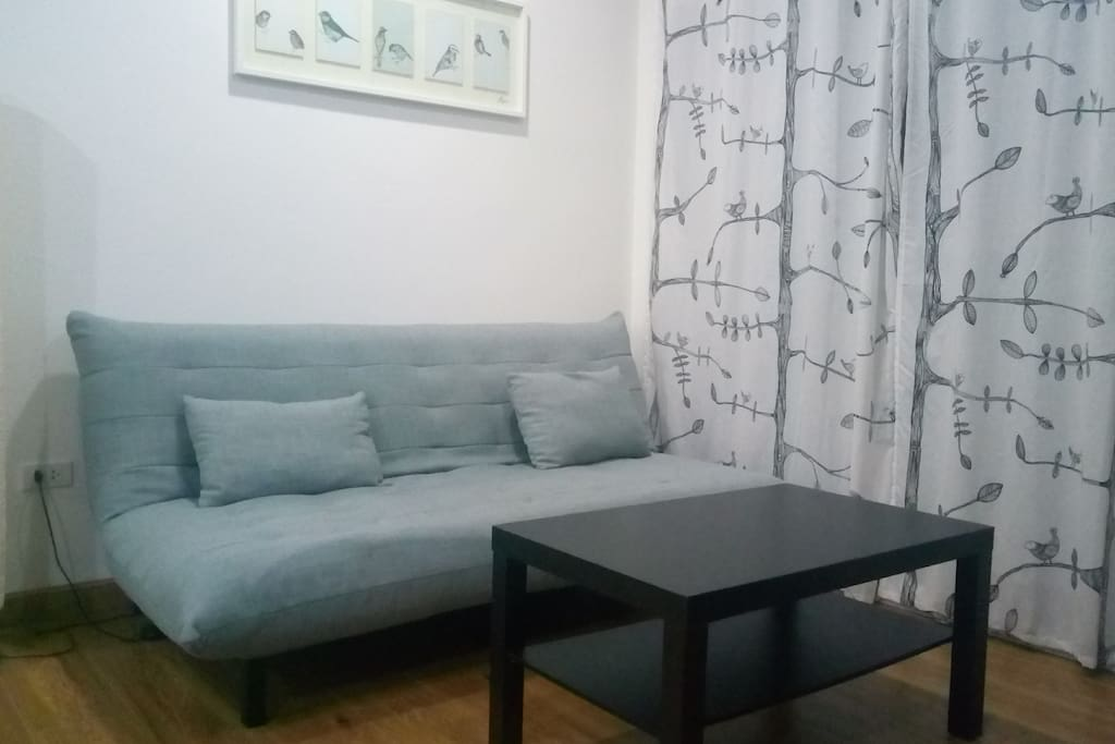 You will find a very comfortable sofa in the livingroom, at night this sofa also can serve as a bed. A wide selection of TV Channels can be accessed on the big modern tv.