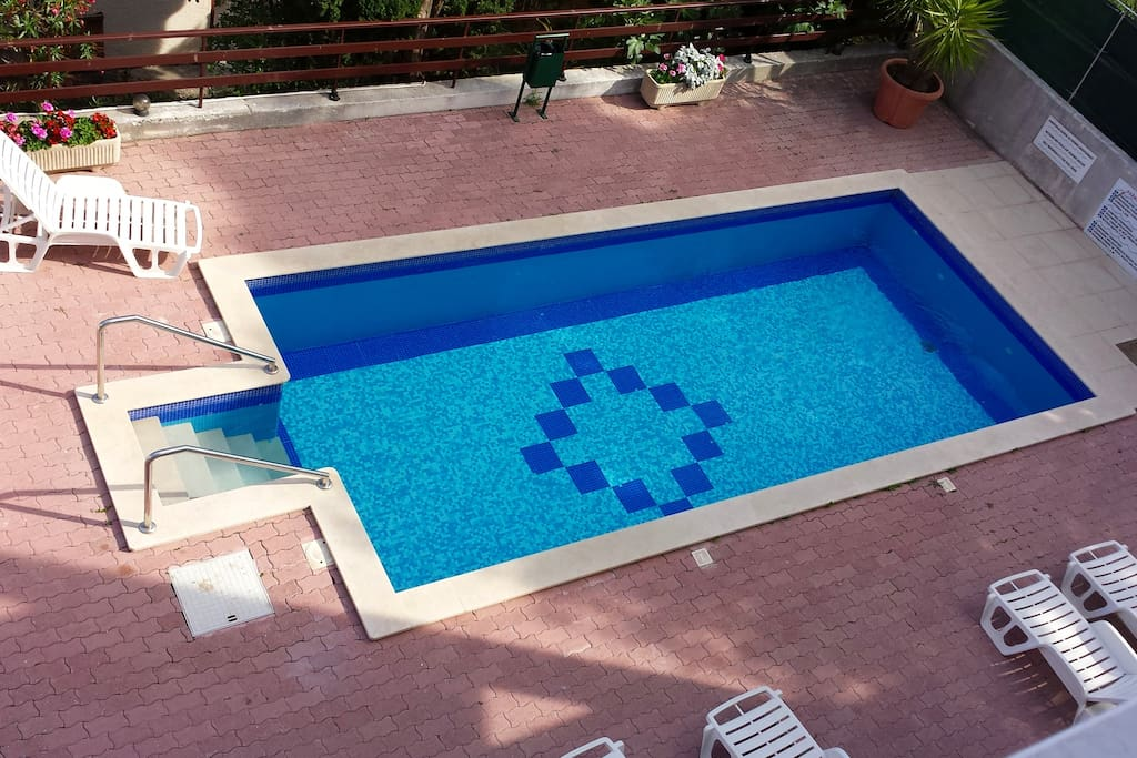 The swimming pool area with plenty of room all around for the kids to play!